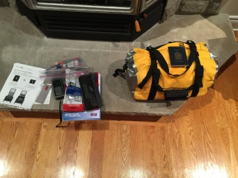 The yellow water bag contains all of the gear, except what you see on the left