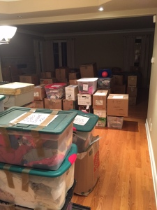 Living room full of our belongings in boxes ready to be sold, thrown out, or given away