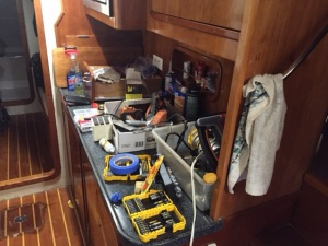 Damaged flooring locker appears to the left of the photo along with tools