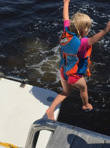 Karen (age 4), previously timid in the water, can now leap into the water from the back of our catamaran.