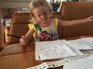 Karen learning to print the alphabet.