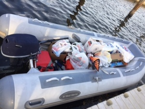 Dinghy loaded with the equivalent of three grocery carts' worth of stuff.