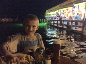 Paul enjoys a dockside supper outside the Island Grill at Mandalay, Key Largo.