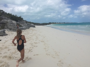 Betty runs along the beach at Shroud Cay.