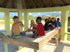 Our kids with their new friends in Abraham's Bay, Mayaguana.